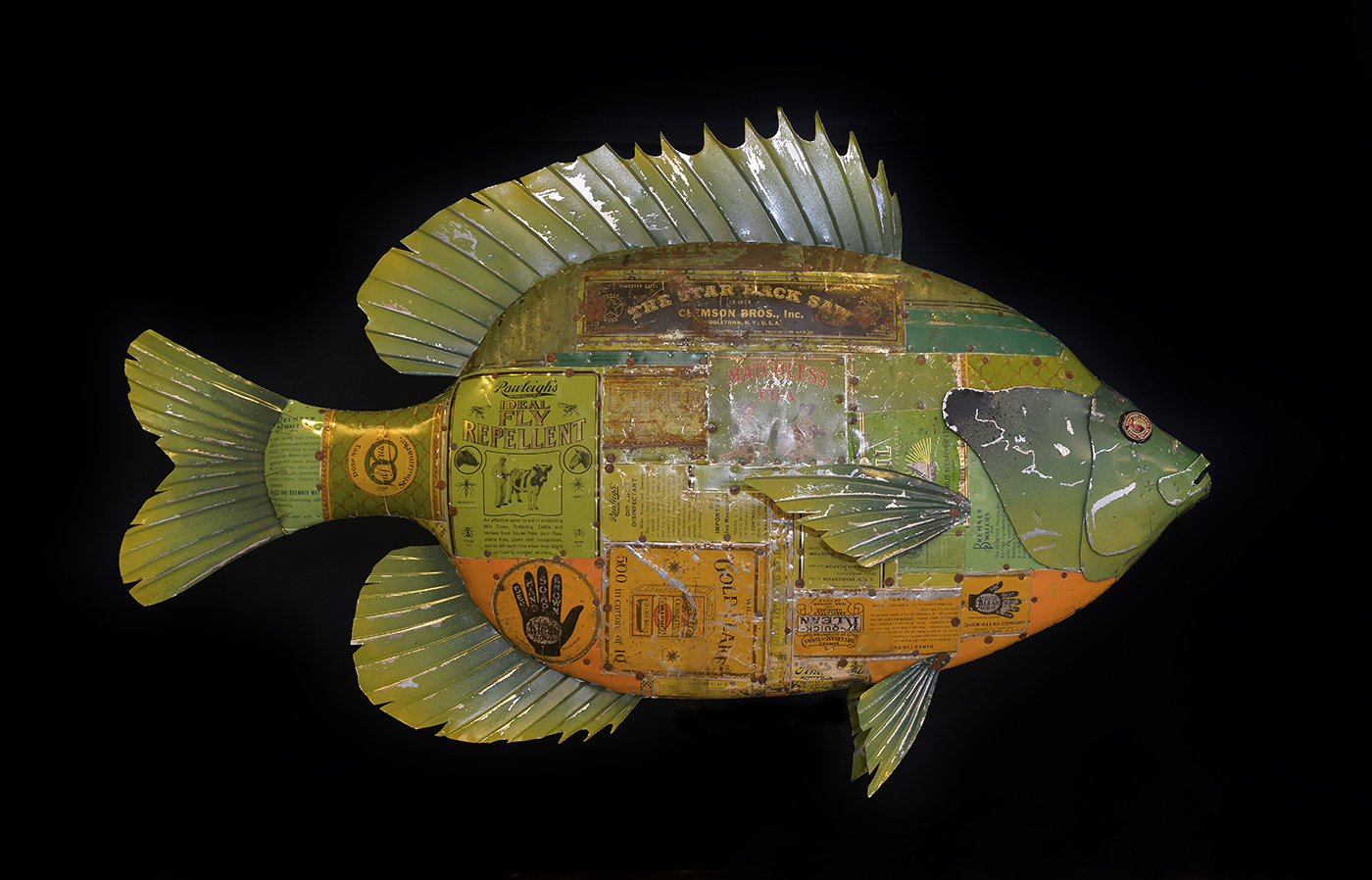 "Bream, 38"", antique advertising tins and sheet steel over wood, paint"